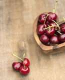 Fresh Summer cherries in wooden bowl Royalty Free Stock Photography