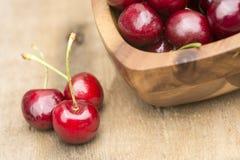 Fresh Summer cherries in wooden bowl Stock Photo