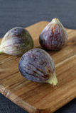Fresh summer figs on wooden table. Fresh summer figs on an vintage wooden board Stock Photo