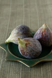 Fresh summer figs on wooden table. Fresh summer figs on an vintage plate on wooden table Royalty Free Stock Photos