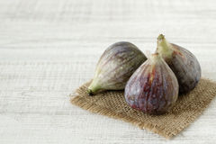 Fresh summer figs on wooden table. Fresh summer figs on an vintage plate on wooden table Stock Image