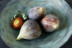 Fresh summer figs on wooden table. Fresh summer figs on an vintage plate on wooden table Royalty Free Stock Photo