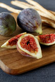 Fresh summer figs on wooden table. Fresh summer figs on an vintage plate on wooden table Stock Photography