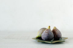 Fresh summer figs on wooden table. Fresh summer figs on an vintage plate on wooden table Royalty Free Stock Image