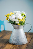 Fresh summer flowers in rustic vase, on wooden table Royalty Free Stock Image