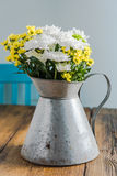 Fresh summer flowers in rustic vase, on wooden table Stock Photography