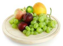 Fresh summer fruit. On wooden plate Stock Image