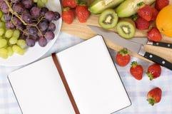 Fresh summer fruit salad blank recipe book copy space Stock Photo