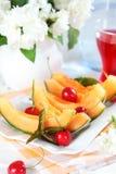 Fresh summer fruits. Summer refreshment - delicious fresh fruits Royalty Free Stock Image