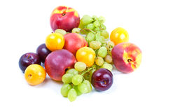 Fresh summer fruits. (nectarines, grapes, black and yellow plums) isolated on white royalty free stock images