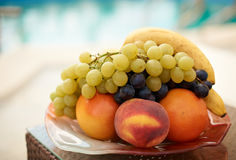 Fresh summer fruits. And blue sea water Royalty Free Stock Image