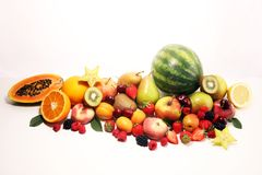 Fresh summer fruits with apple, peach, papaya, berries, pear and apricot stock images