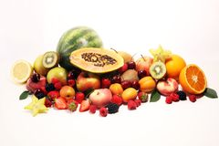 Fresh summer fruits with apple, peach, papaya, berries, pear and apricot stock photography