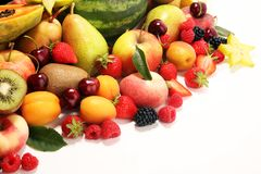 Fresh summer fruits with apple, peach, papaya, berries, pear and apricot royalty free stock photo