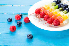 Fresh summer fruits on blue wooden table Royalty Free Stock Photos
