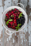 Fresh summer fruits in a colander. Fresh summer fruits mix in a colander Royalty Free Stock Photos
