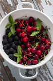 Fresh summer fruits in a colander. Fresh summer fruits mix in a colander Stock Images