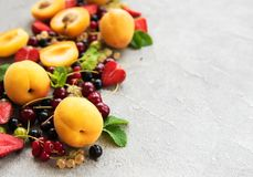Fresh summer fruits. On a concrete background royalty free stock image