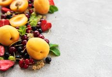 Fresh summer fruits. On a concrete background stock photo