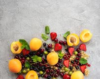 Fresh summer fruits. On a concrete table royalty free stock photos