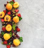 Fresh summer fruits. On a concrete table stock photography
