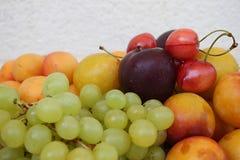Fresh Summer Fruits. A mix of fresh summer fruits on white Stock Photo