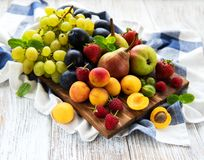 Fresh summer fruits. On a old wooden table stock photos
