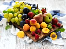 Fresh summer fruits. On a old wooden table stock photo
