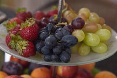 Fresh summer fruits. Organic and natural fruit on tray. Fresh grapes, cheaches, plums and strawberry. Healthy eating. Breakfast Stock Photo