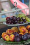 Fresh summer fruits. Organic and natural fruit on tray. Fresh grapes, cheaches, plums and strawberry. Healthy eating. Breakfast Royalty Free Stock Image
