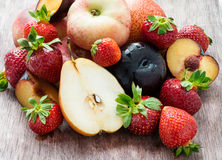 Fresh summer fruits over wooden background. Selective focus Royalty Free Stock Photos