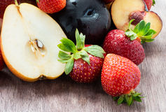 Fresh summer fruits over wooden background Royalty Free Stock Images