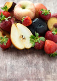 Fresh summer fruits over wooden background. Selective focus, copy space Stock Images