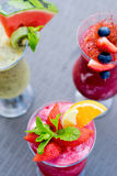 Fresh summer fruity smoothies Royalty Free Stock Images