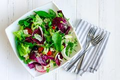 Fresh summer green salad mix on a wooden table Royalty Free Stock Image