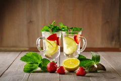Fresh Summer Healthy Drink With Lemon And Strawberries With Ice. Stock Photos
