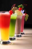 Fresh summer juices. A Row of colorful juices Royalty Free Stock Photography