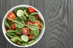 Fresh summer organic salad with tomatoes cucumbers Royalty Free Stock Image