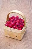 Fresh summer raspberry in basket on table. Fresh sweet summer raspberry in basket on wooden table Royalty Free Stock Photos
