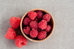 Fresh summer raspberry in a wooden bowl. Top view. Fresh summer raspberry in the wooden bowl. Top view Royalty Free Stock Photography