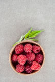 Fresh summer raspberry in a wooden bowl. Top view. Royalty Free Stock Photo