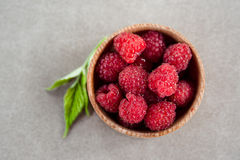 Fresh summer raspberry in a wooden bowl. Top view. Fresh summer raspberry in the wooden bowl. Top view Stock Photo