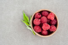 Fresh summer raspberry in a wooden bowl. Top view. Fresh summer raspberry in the wooden bowl. Top view Stock Image