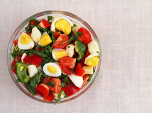 Fresh summer salad in bowl. Top view. Royalty Free Stock Image