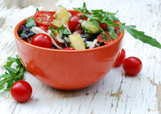 Fresh summer salad with cherry tomatoes. Basil leaves and other vegetables Stock Photos