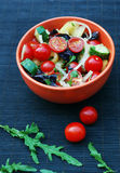 Fresh summer salad with cherry tomatoes. Basil leaves and other vegetables Stock Photo