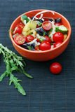 Fresh summer salad with cherry tomatoes. Basil leaves and other vegetables Stock Images