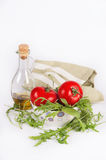 Fresh summer salad ingredients: red ripe tomatoes, rucola salad and olive oi Stock Photography