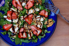 Fresh summer salad with strawberries Royalty Free Stock Image