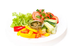 Fresh summer salad on white plate Stock Images